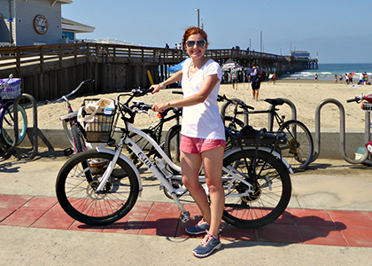Patricia-with-E-bike-at-Newport-Beach