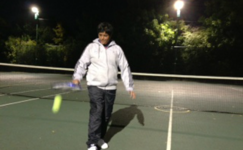 Geek girl plays tennis in the dark