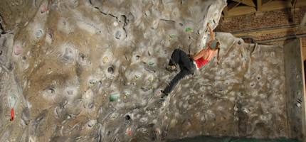 Audrey bouldering at The Castle climbing centre